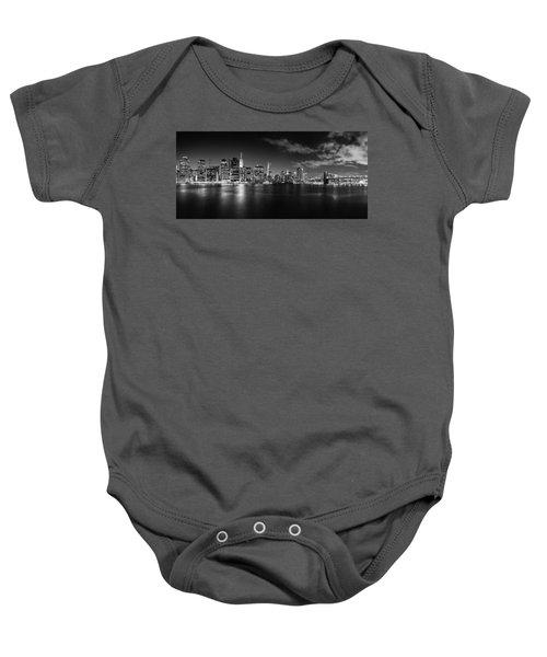 Manhattan Skyline At Night Baby Onesie by Az Jackson