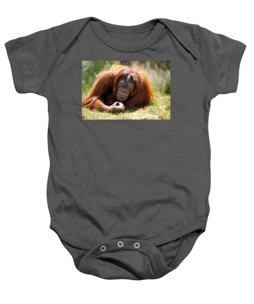 Orangutan In The Grass Baby Onesie by Garry Gay