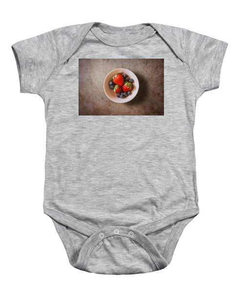 Strawberries And Blueberries Baby Onesie by Scott Norris