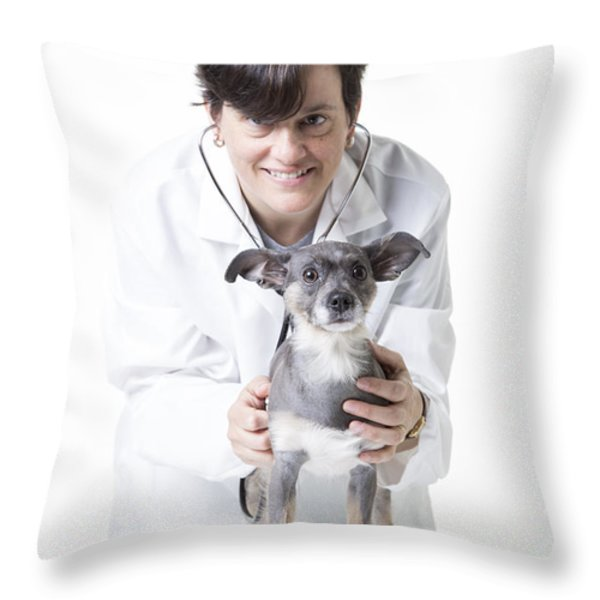 Cute little dog at the vet Throw Pillow by Edward Fielding