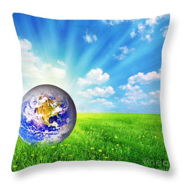Earth Globe On Green Grass Throw Pillow by Michal Bednarek