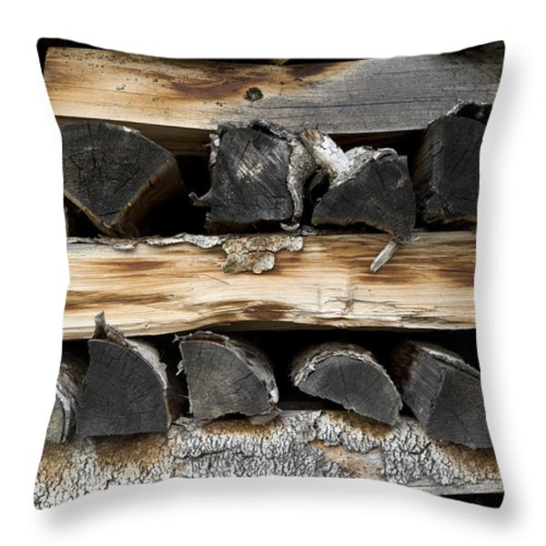 Firewood Stack Throw Pillow by Frank Tschakert