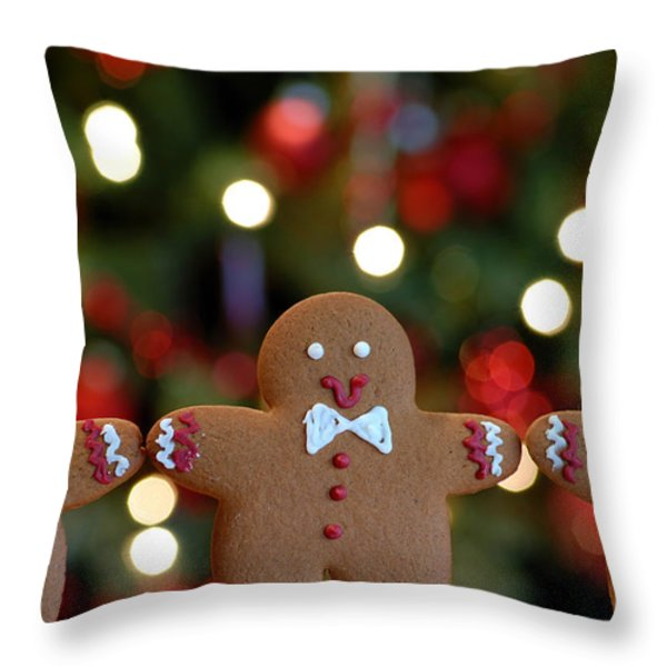 Gingerbread Men In A Line Throw Pillow by Amy Cicconi