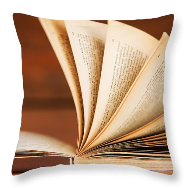 Open book in retro style Throw Pillow by Michal Bednarek