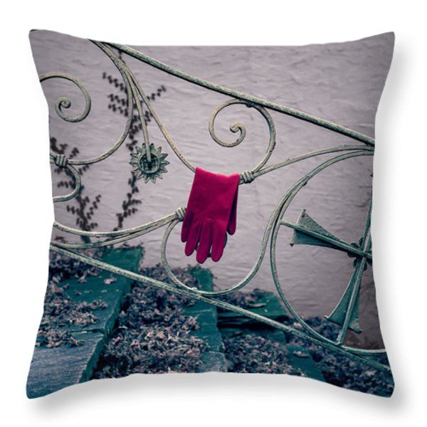 red glove Throw Pillow by Joana Kruse