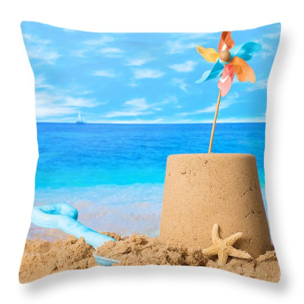 Sandcastle On Beach Throw Pillow by Amanda And Christopher Elwell