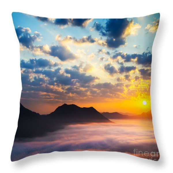 Sea of clouds on sunrise with ray lighting Throw Pillow by Setsiri Silapasuwanchai