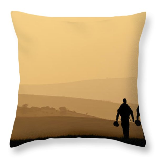 Silhouette of military attack aircraft against vibrant sunset sk Throw Pillow by Matthew Gibson