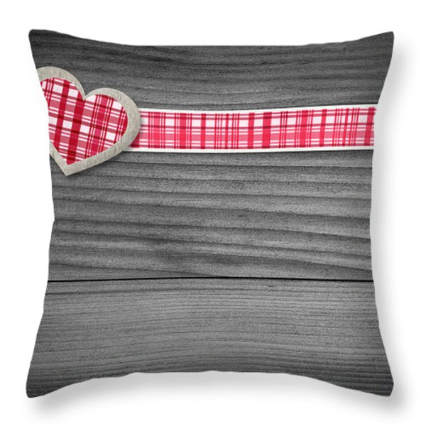 Two Hearts Laying On Wood  Throw Pillow by Aged Pixel