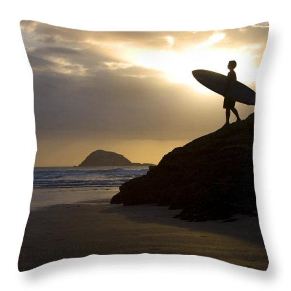 A Surfer On Muriwai Beach New Zealand Throw Pillow by Deddeda
