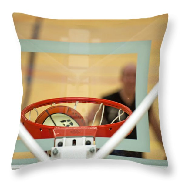 Ball on its way to the basket Throw Pillow by Jan Marijs