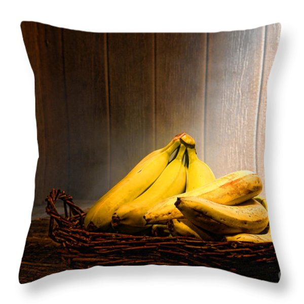 Bananas Throw Pillow by Olivier Le Queinec