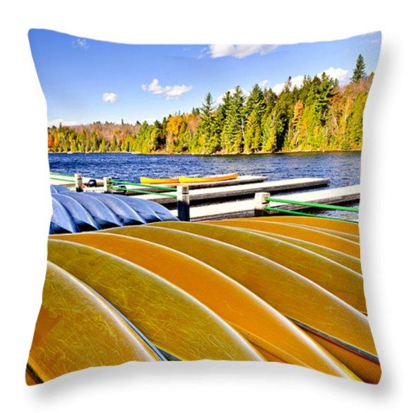 Canoes On Autumn Lake Throw Pillow by Elena Elisseeva