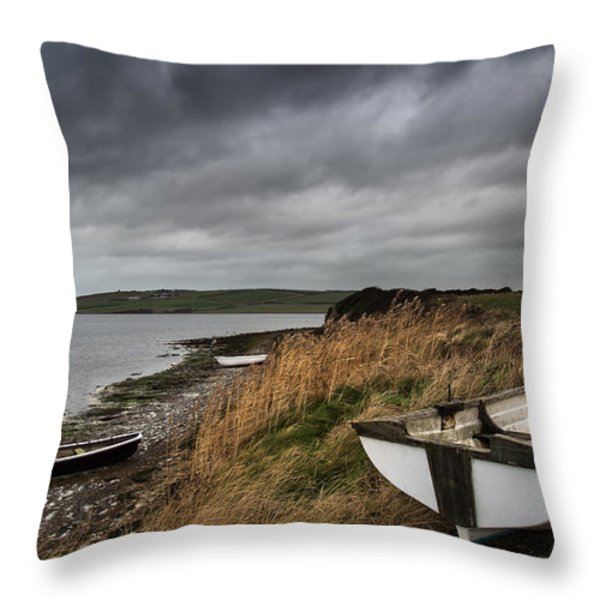 Old Decayed Rowing Boats On Shore Of Lake With Stormy Sky Overhe Throw Pillow by Matthew Gibson