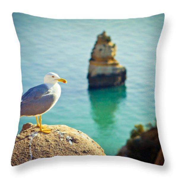 seagull on the rock Throw Pillow by Raimond Klavins