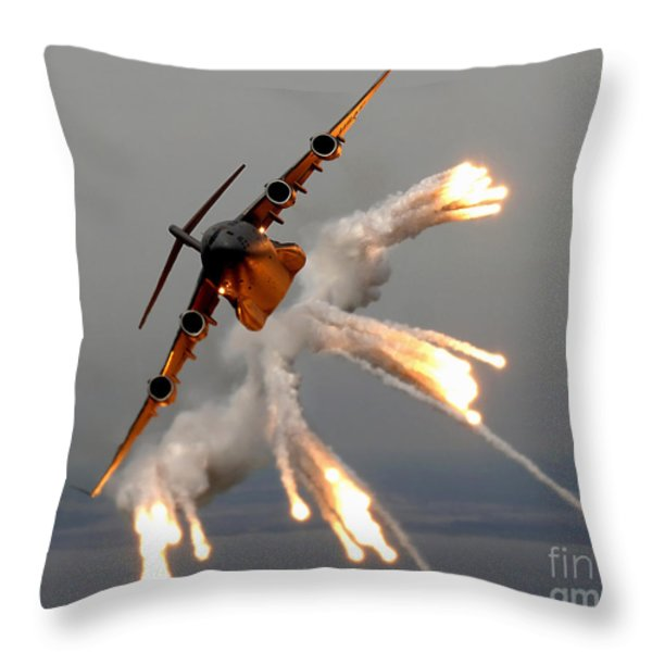 A C-17 Globemaster IIi Releases Flares Throw Pillow by Stocktrek Images