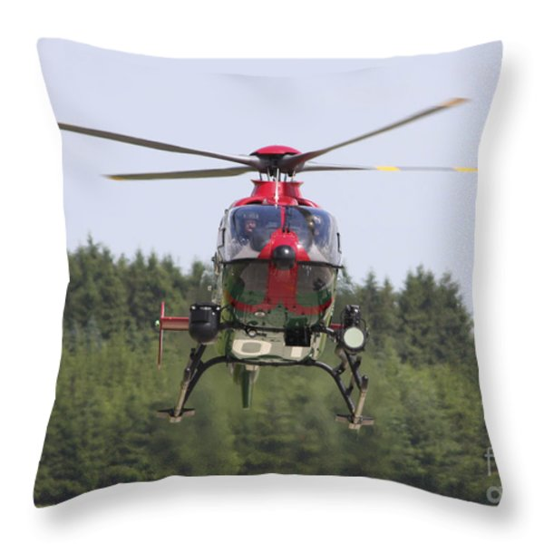 A Eurocopter Ec135 Used By German Throw Pillow by Timm Ziegenthaler