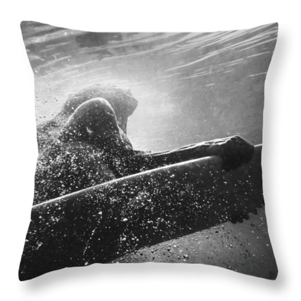 A Woman On A Surfboard Under The Water Throw Pillow by Ben Welsh