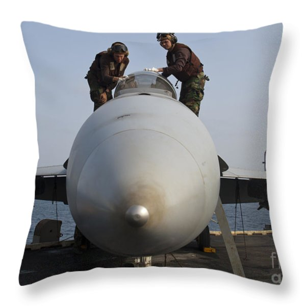 Airmen Clean The Canopy Of An Fa-18f Throw Pillow by Stocktrek Images