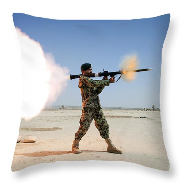 An Afghan National Army Soldier Fires Throw Pillow by Stocktrek Images