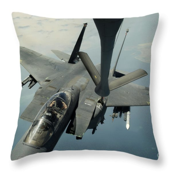 An F-15e Strike Eagle Receives Fuel Throw Pillow by Stocktrek Images