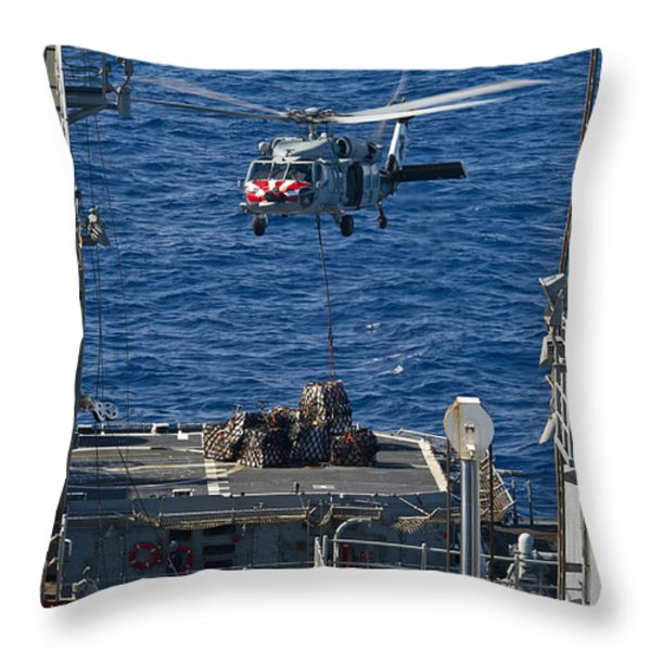 An Mh-60s Sea Hawk Delivers Supplies Throw Pillow by Stocktrek Images