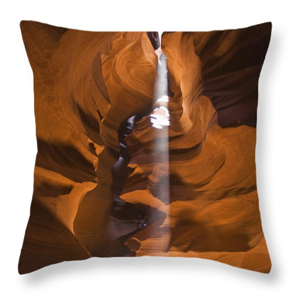 Antelope Canyon A Narrow Canyon Carved Throw Pillow by Brian Guzzetti