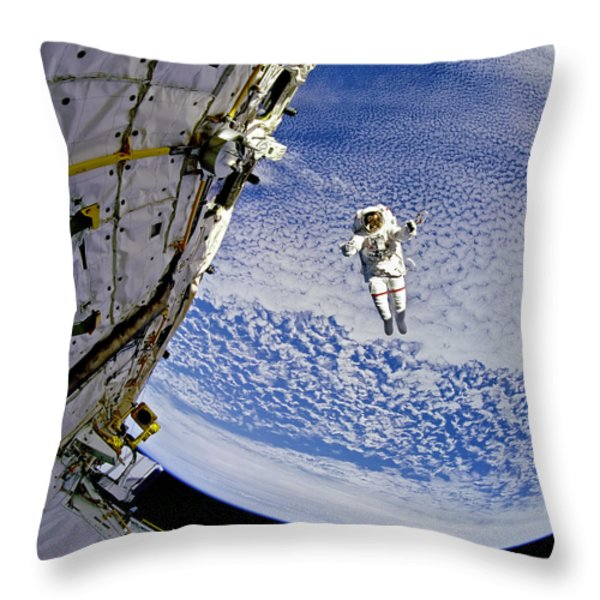 Astronaut in Atmosphere Throw Pillow by The  Vault - Jennifer Rondinelli Reilly