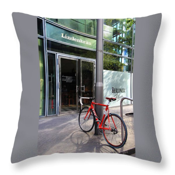Berlin Street View With Red Bike Throw Pillow by Ben and Raisa Gertsberg