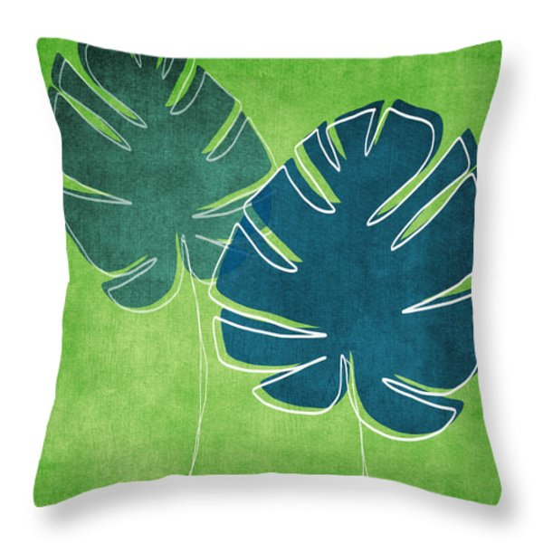 Blue and Green Palm Leaves Throw Pillow by Linda Woods