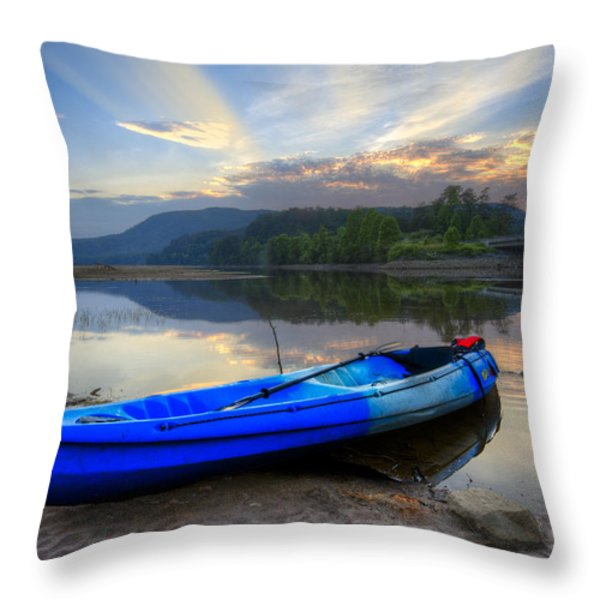 Blue Canoe At Sunset Throw Pillow by Debra and Dave Vanderlaan