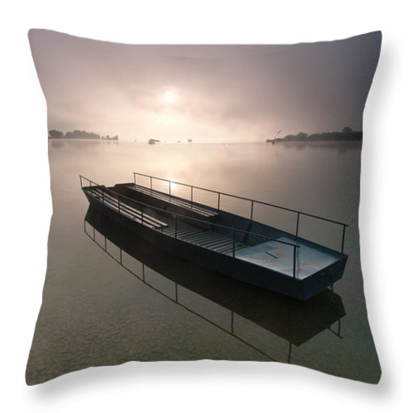 Boat on foggy lake Throw Pillow by Davorin Mance