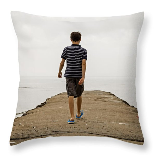 Boy Walking On Concrete Beach Pier Throw Pillow by Edward Fielding