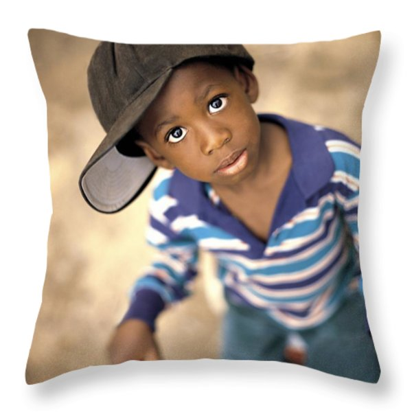 Boy Wearing Over Sized Hat Riding Bike Throw Pillow by Ron Nickel