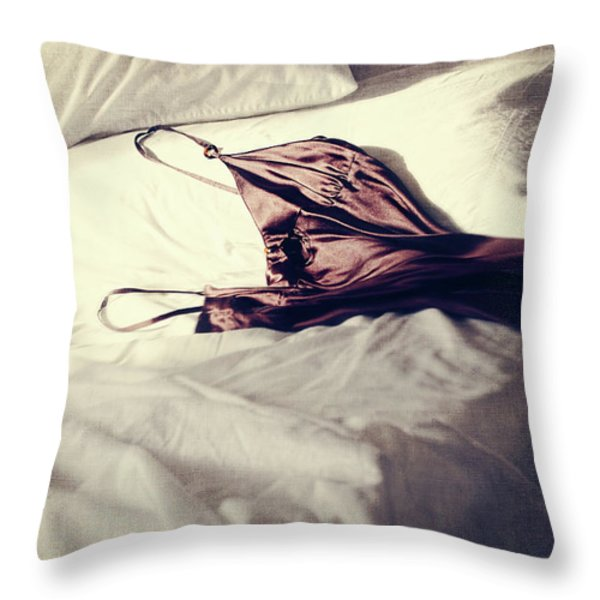 Brown negligee laying across sheets on bed Throw Pillow by Sandra Cunningham