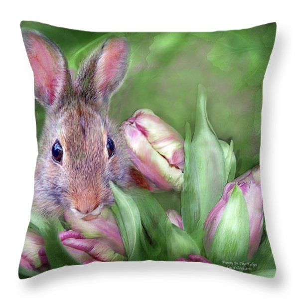 Bunny In The Tulips Throw Pillow by Carol Cavalaris
