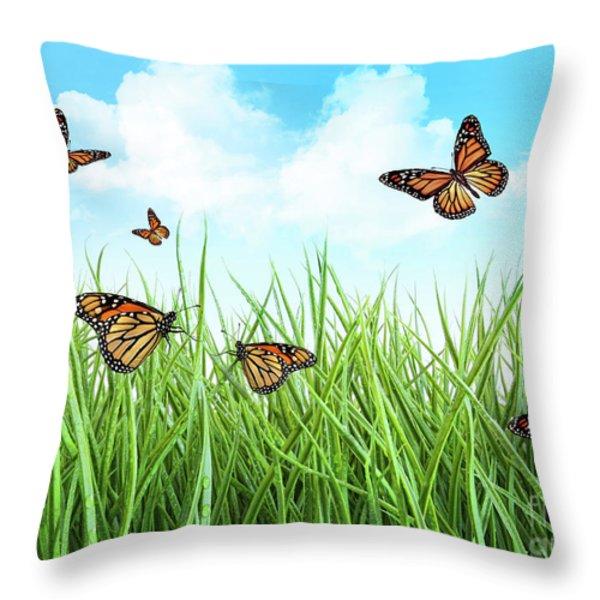 Butterflies In Tall Wet Grass Throw Pillow by Sandra Cunningham