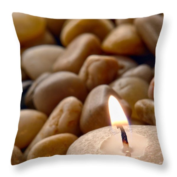 Candle on the Rocks Throw Pillow by Olivier Le Queinec