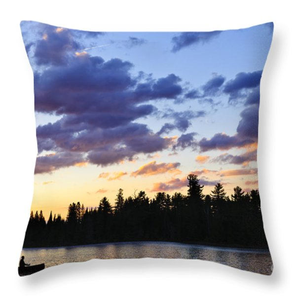 Canoeing At Sunset Throw Pillow by Elena Elisseeva