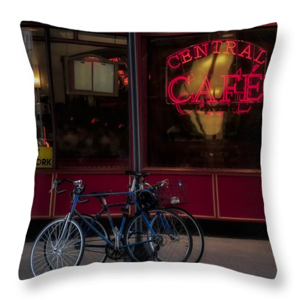 Central Cafe Bicycles Throw Pillow by Susan Candelario