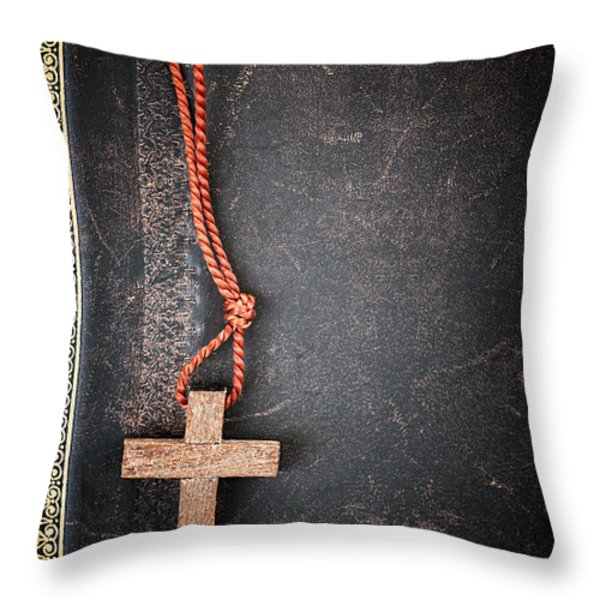 Christian Cross on Bible Throw Pillow by Elena Elisseeva