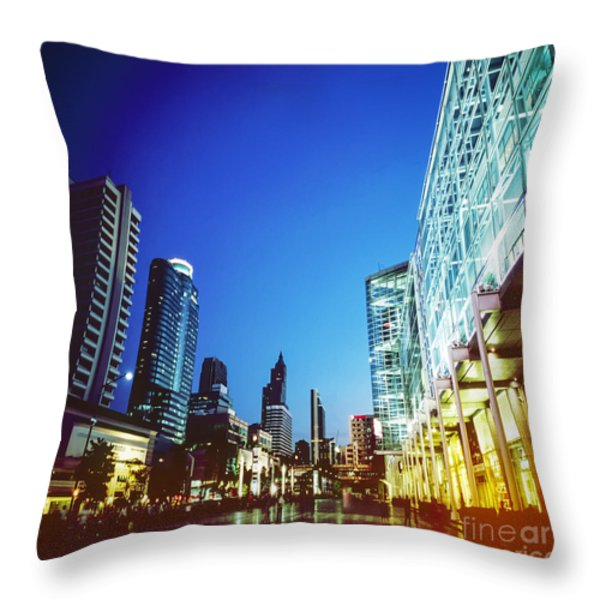 city in twilight Throw Pillow by Setsiri Silapasuwanchai