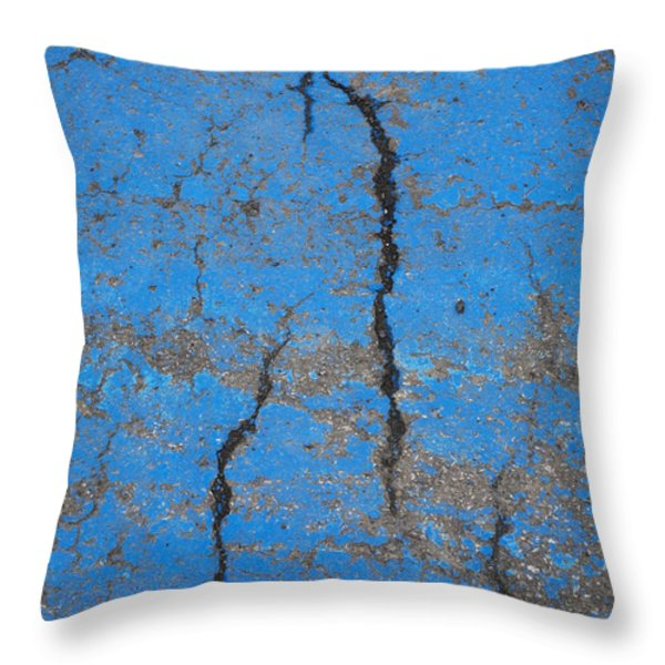 Close Up Of Cracks On A Blue Painted Throw Pillow by Perry Mastrovito