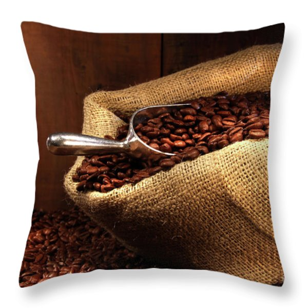 Coffee beans in burlap sack Throw Pillow by Sandra Cunningham