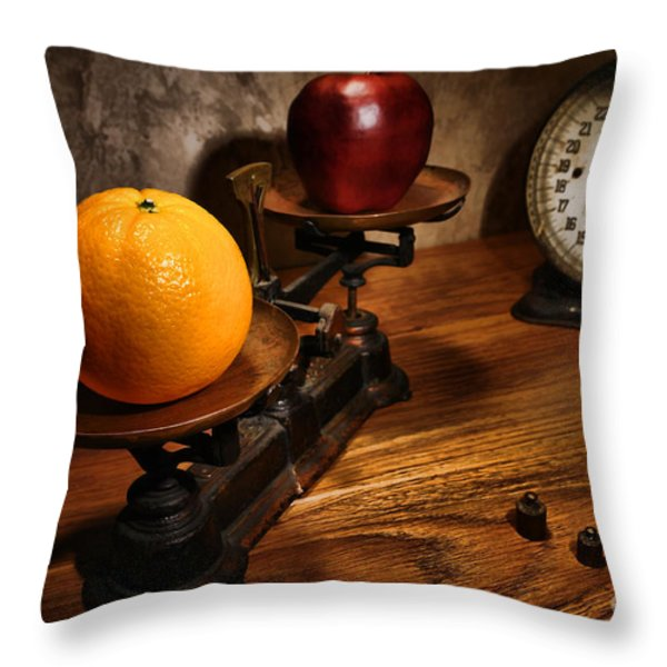Comparing Apple And Orange Throw Pillow by Olivier Le Queinec