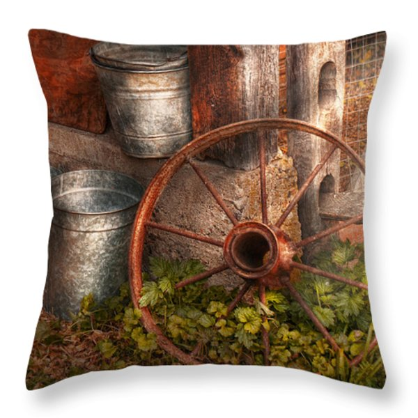 Country - Some dented pails and an old wheel  Throw Pillow by Mike Savad