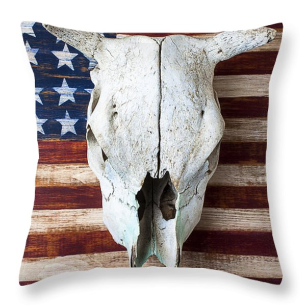 Cow skull on folk art American flag Throw Pillow by Garry Gay