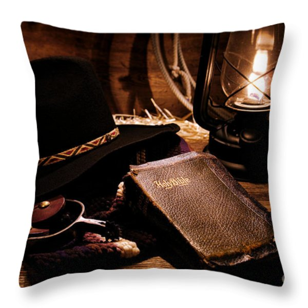 Cowboy Bible Throw Pillow by Olivier Le Queinec