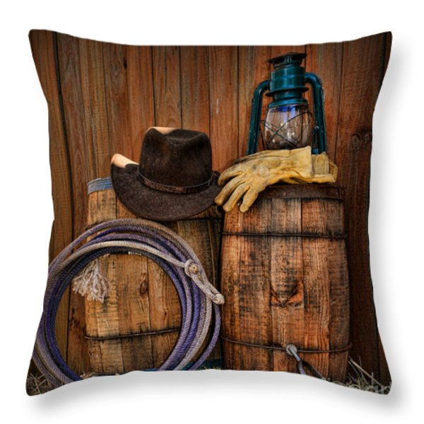 Cowboy Hat and Bronco Riding Gloves Throw Pillow by Paul Ward