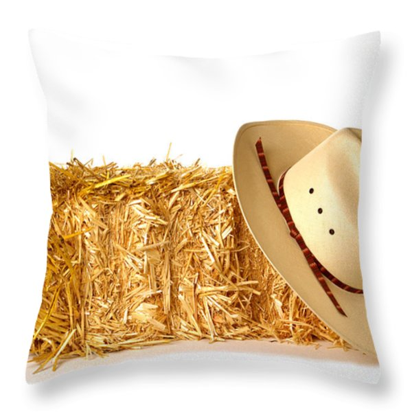 Cowboy Hat on Straw Bale Throw Pillow by Olivier Le Queinec